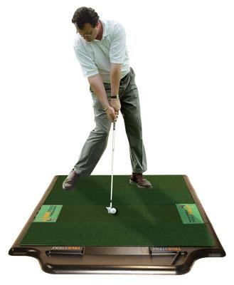 Daniel Fitzsimmons hitting off a TrueStrike Golf Mat