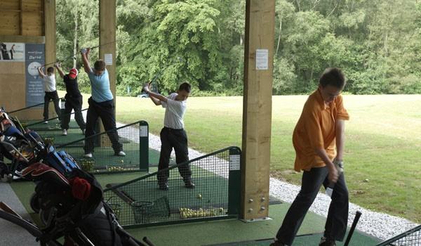 Golfers practiciing on TrueStrike Golf Mat at Poult Wood