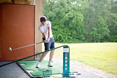 Golfer practicing on TrueStrike Golf Mat at Poult Wood